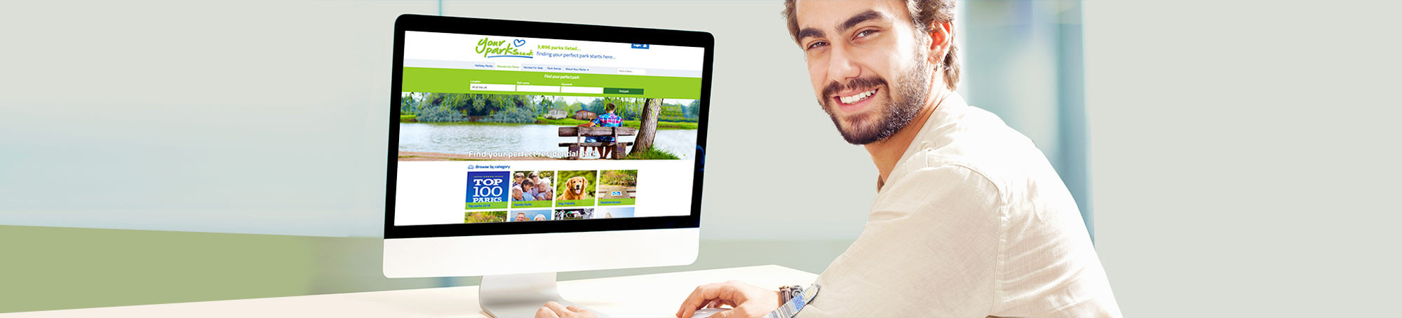 A man browsing for his next adventure on the Your Parks website